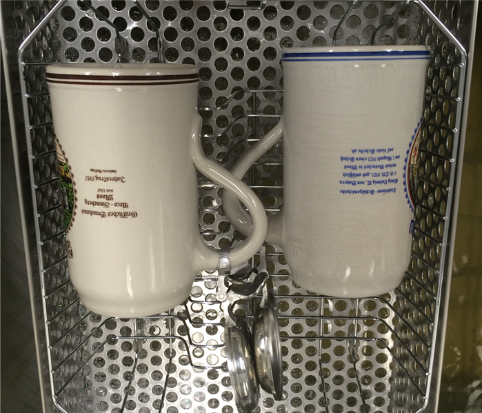 2 clean mugs in a metal basket
