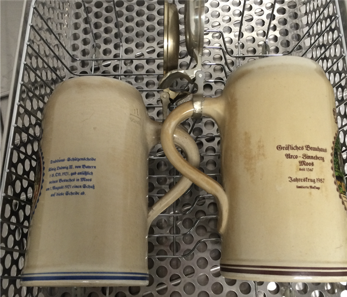 2 mugs in a metal basket covered in smoke