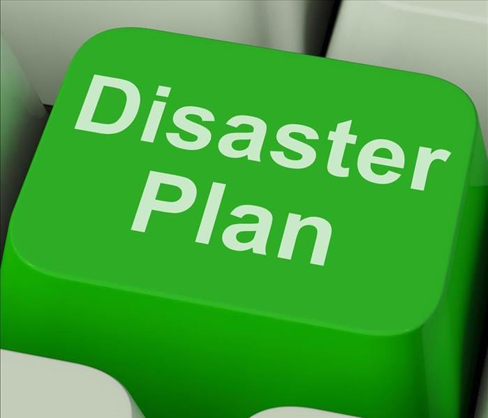 A green computer key that says Disaster plan